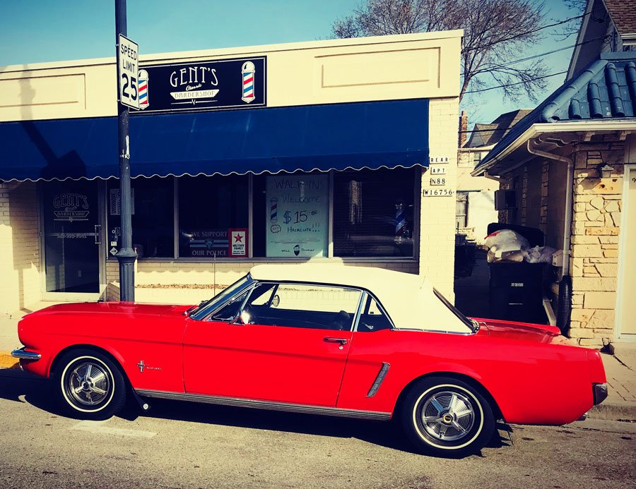 gents classic barbshop in menomonee falls on appleton and main street with classic red car out front