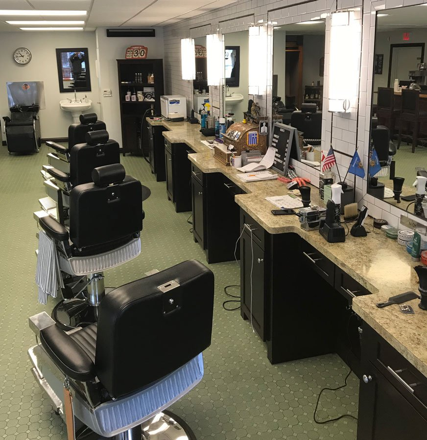 inside gents barbershop clean barber chairs and counters