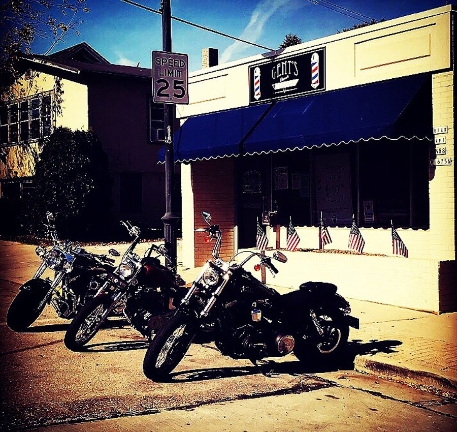 motorcycle biker hair cuts and gents classic barbershop store front on appleton avenue