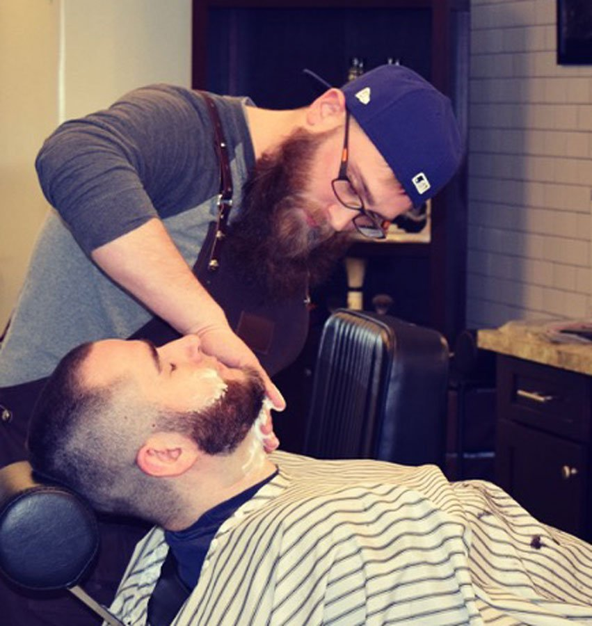 will at gents barbershop focusing on straight razor neck shave