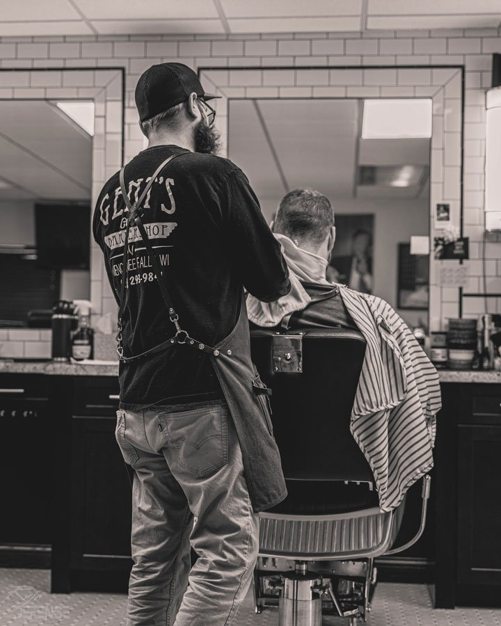 will finishing up shaving beard and neck after haircut at gents barbershop in menomonee falls