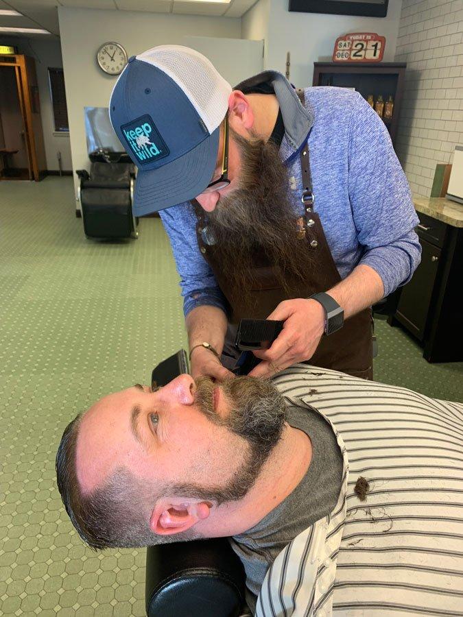 will shaving guys beard at gents barbershop in menomonee falls